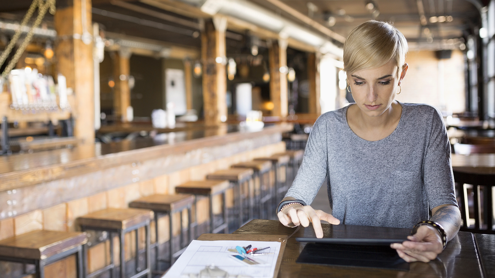 Female pub owner using tablet.