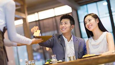 Couple paying for dinner in restaurant